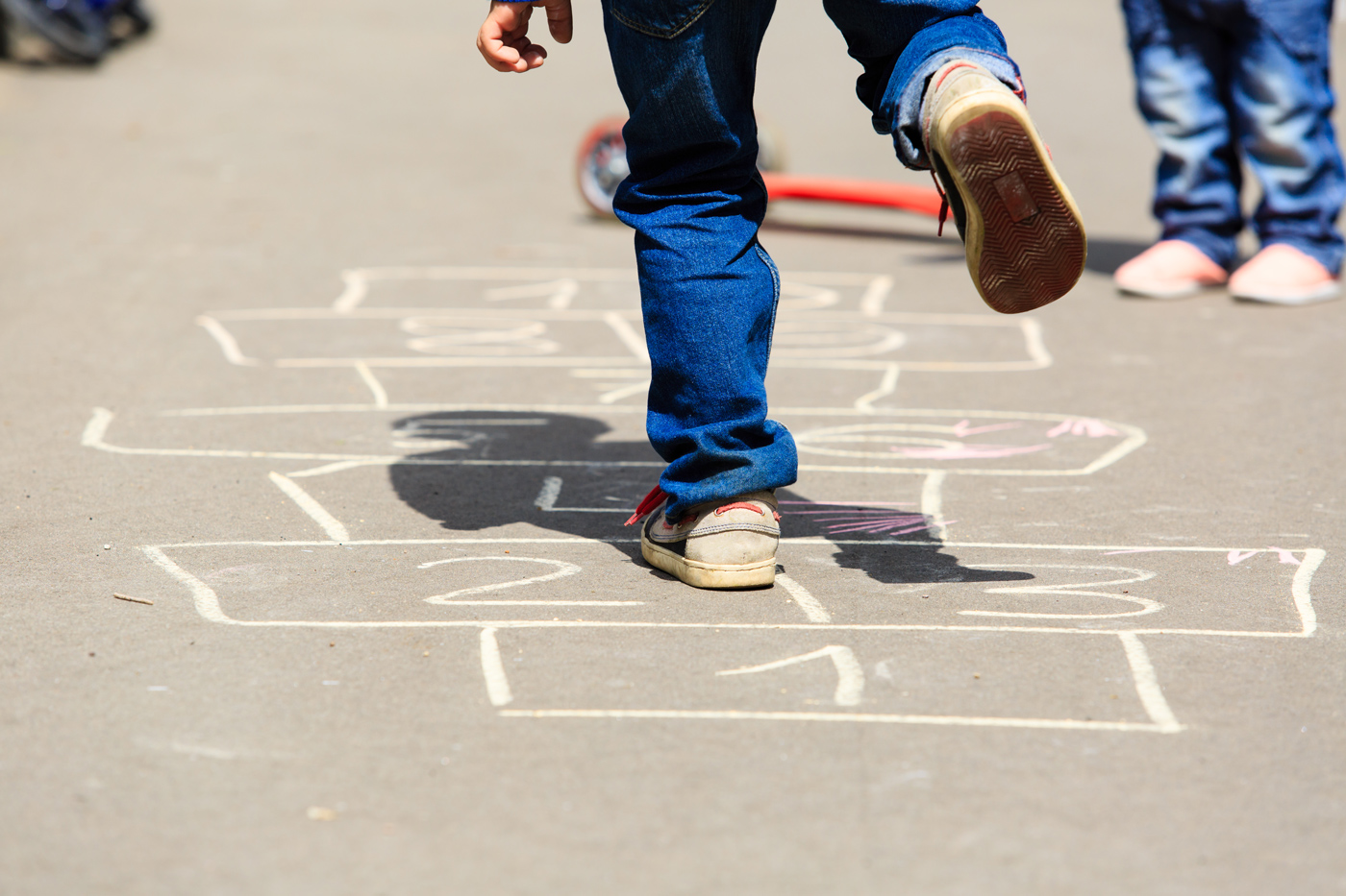 Kid-Playing-Hopscotch